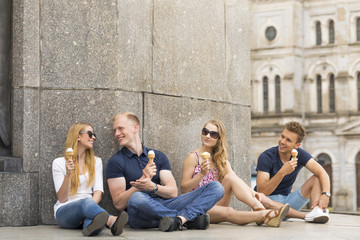 Two couples eating ice creams