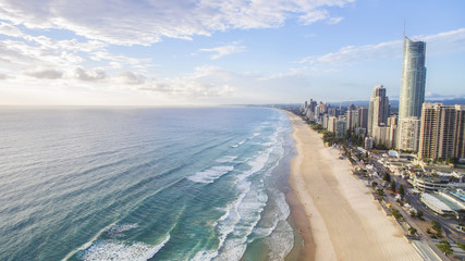 Aerial view of sunrise beaming across the beach at Gold Coast Surfers Paradise