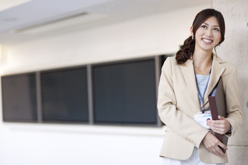 A business woman holding file