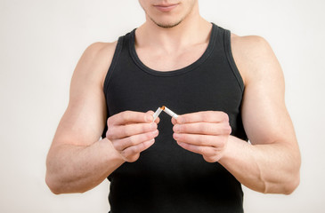 Quit smoking - Young man crushing cigarette