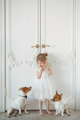 Girl with dogs in the room