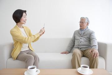 Senior couple taking photo with smartphone