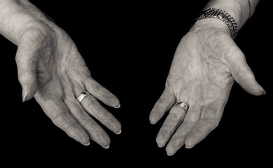 Black and white image of older lady's empty hands,