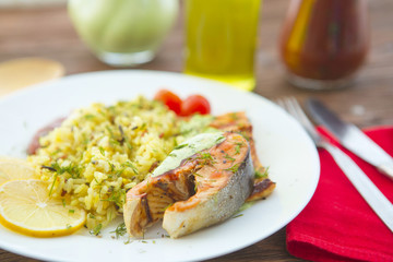 Rise noodles with salmon and vegetable on wooden table