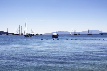 Sail boats (yachts) in front of Bodrum city center. It is sunny summer day.