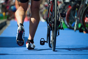 Running triathlete in the transition zone,triathlon bike the transition zone