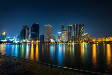 BANGKOK, THAILAND, MARCH  04, 2017 - Panorama of cityscape with skyscrapers and sky line by night from Benjakitti Park in Bangkok, Thailand