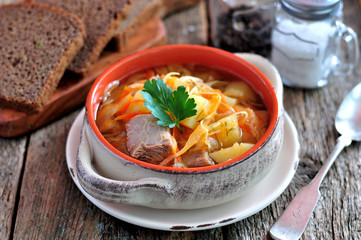 Soup of beef ribs, sauerkraut, onions, carrots and parsley.