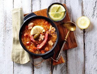 Traditional thick soup made from sauerkraut with pork, smoked pork ribs, sausages, capers and lemon.