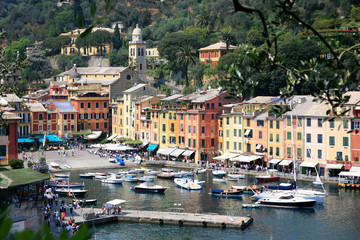 Portofino, Italy - marina and shops. Colorful buildings in a picturesque setting.