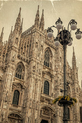 Old photo with facade of the famous Milan Cathedral, Lombardy, Italy