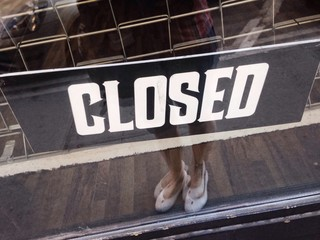 Sign Closed on a door of a shop