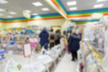 Blurred background image of supermarket or shopping mall.
