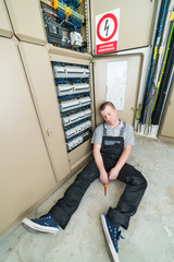 electrician lying on the ground