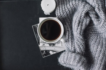 Flatlay of winter sweater and coffee