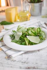 vegetarian Green salad with Parmesan arugula avocado nuts