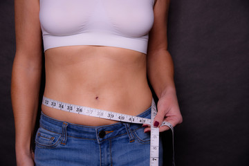 A Slim Woman Measuring Her Waist