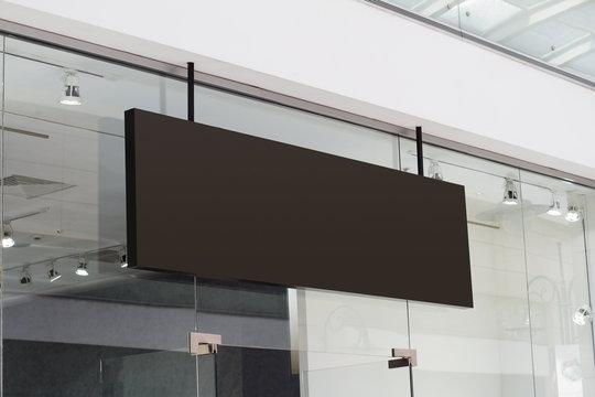 horizontal black signage on shop front