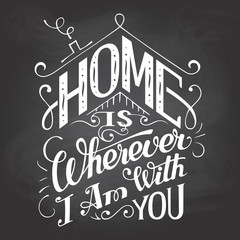 Home is wherever I am with you. Chalkboard wall sign. Hand-lettering on blackboard background with chalk. Decorative typography