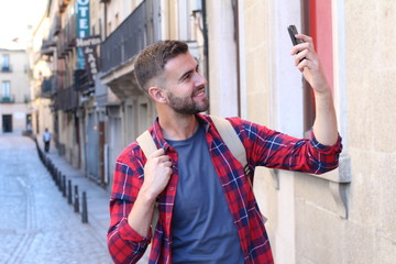Man snapping a selfie for social media