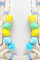 Frame with Easter eggs painted in pastel colors on a white background. Frame