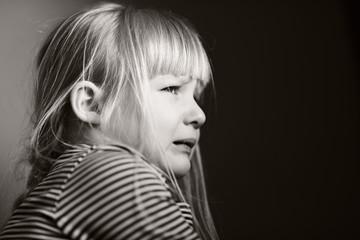 Sad crying child.