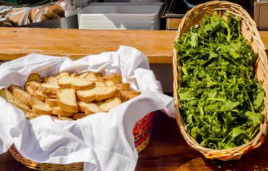 Bread and fresh broccoli rabe - Cima di rapa - Brassica rapa