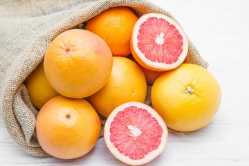 canvas sack full of  grapefruit