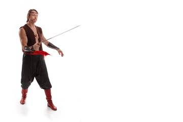 Actor Athlete man in trousers with naked torso posing with a Chinese sword on a white background in studio