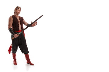 Actor Athlete man in trousers posing with a Chinese sword on a white background in studio