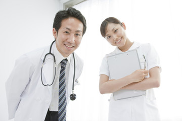 Doctor and nurse looking into camera