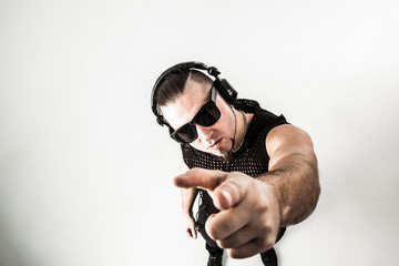 view from the top - DJ - rapper with headphones on a light background.