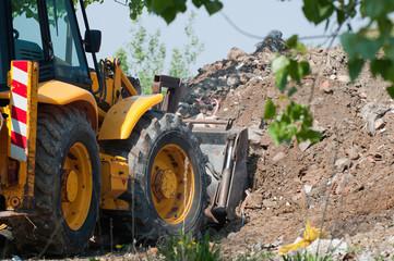 Loader moving construction debris