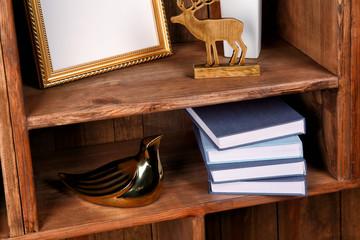 New books on wooden shelf