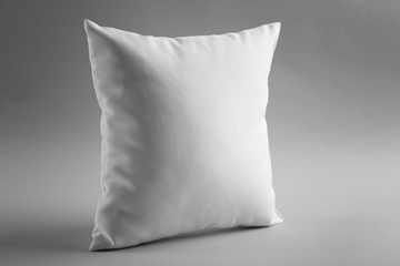 Blank white pillow on grey background