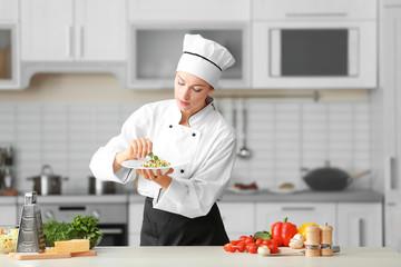 Female chef preparing in kitchen