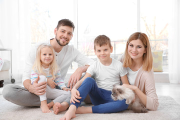 Parents with children and cat at home