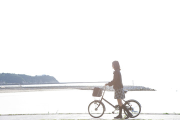 Junior High School girl with a bicycle