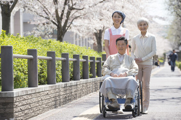 Wheel chaired patient and nurse looking at cherry blossoms