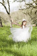 Pretty Little Girl Dancing In Field