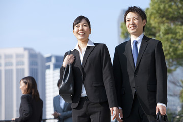 Young Businessman and Businesswoman Smiling