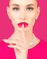 Portrait of an elegant young woman on a pink background