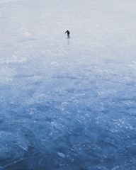 Solo Skater on Frozen Lake