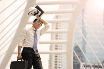 Tired or stressful businessman stop walking in city after working