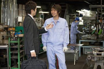 Male Worker Talking to Boss