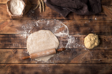 Wall Mural - Roll out dough with rolling pin and flour
