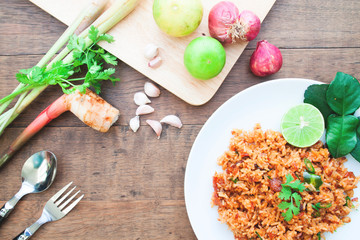 Thai food spicy fried rice with ingredients on wood table, Overhead view shot
