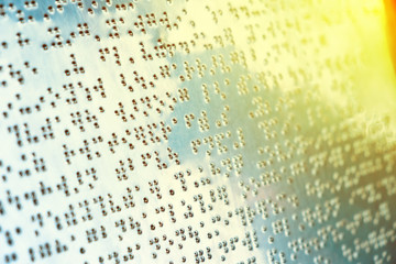 Braille text on metal sheet for blind people with color filter added