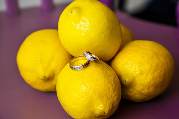 Wedding rings on lemons