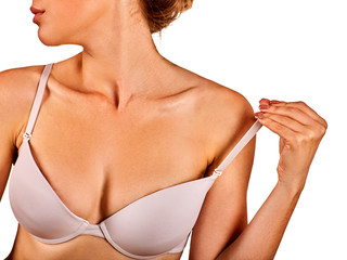 Self examination of women breast cancer. Woman wear lace bra. Body part of girl with beautiful breasts and lips on white background removes one strap bra with shoulder. Gentle profile of young lady.